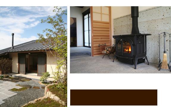 左/大屋根にすっと伸びる煙突がC邸のアクセント。 上/奥に見えるのが玄関。この薪ストーブ1台で家中を暖めてくれる。